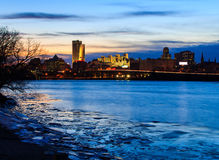 Albany NY skyline at night reflections off the Hudson River Royalty Free Stock Images