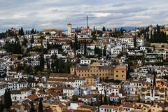 Albazin in Granada, Spain. Beautiful district in Granada, Spain. White houses and mountains in the background Stock Photo