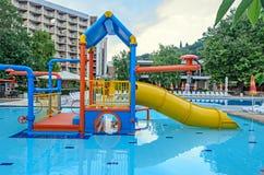 Colored water tube slide, blue pool entertaiment sports, close up. ALBENA, BULGARIA - JUNE 16, 2017: Colored water tube slide, blue pool entertaiment sports Stock Photos
