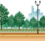 Alberino della lampada e del giardino sulla strada royalty illustrazione gratis