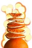 Albero decorativo dalle fette arancio con bokeh su un backgro bianco Immagini Stock Libere da Diritti