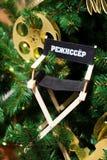 Albero decorato di Chrismas, pino, nuovo anno La parola è tradotta - regista, produttore cinematografico immagini stock