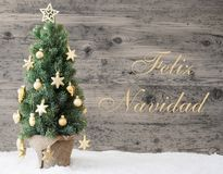 Albero decorato dorato, Feliz Navidad Means Merry Christmas immagini stock