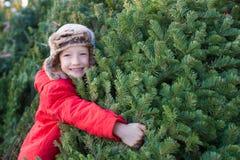 Albero di Natale d'acquisto della famiglia Fotografia Stock Libera da Diritti