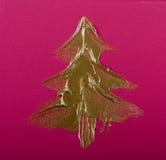Albero di Natale dell'oro sul colore rosa Immagini Stock