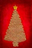 Albero di Natale della catena dorata su colore rosso Immagine Stock