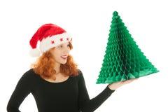 Albero di Natale a disposizione della donna fotografie stock libere da diritti