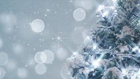 Albero di Natale e primo piano delle scintille dell'argento Immagine Stock