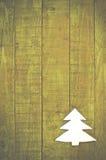 Albero di Natale fatto di feltro su fondo di legno verde Fotografia Stock