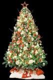 Albero di Natale moderno decorato con gli ornamenti d'annata, le luci ed i regali bianchi rosso Isolato su priorità bassa nera immagini stock libere da diritti