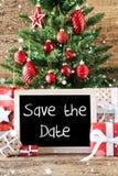 Albero di Natale variopinto, fiocchi di neve, risparmi inglesi del testo la data Fotografie Stock