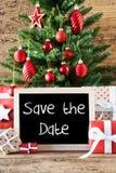 Albero di Natale variopinto, risparmi inglesi del testo la data Immagini Stock