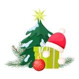 Albero di Natale vicino alla scatola ed a Santa Cap attuali Immagini Stock Libere da Diritti