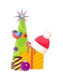 Albero di Natale vicino alla scatola ed a Santa Cap attuali Immagine Stock