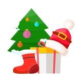 Albero di Natale vicino alla scatola ed a Santa Cap attuali Fotografia Stock