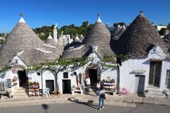 Alberobello. ITALY - MAY 29, 2017: People visit , Italy.  and its trulli houses are a UNESCO World Heritage Site Stock Photos