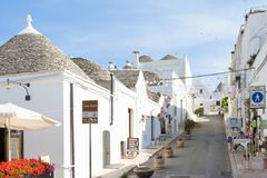 Alberobello, Apulia - JUNE 1, 2017 - A street with traditional l. Alberobello, Apulia, Italy - JUNE 1, 2017 - A street with traditional local architecture stock photography