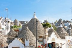 Alberobello, Apulia - Skyline of Alberobello with traditional rooftops. Alberobello, Apulia, Italy - Skyline of Alberobello with traditional rooftops royalty free stock photography