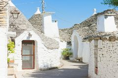 Alberobello, Apulia - Trulli within a very small alleyway. Alberobello, Apulia, Italy - Trulli within a very small alleyway stock photography