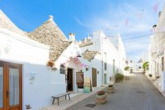 Alberobello, Apulia - Walking up the historical streets of Trulli buildings. Alberobello, Apulia, Italy - Walking up the historical streets of Trulli buildings stock image