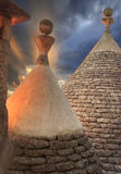 Alberobello: detail of the trullo to dry masonry. ITALY,APULIA.Apulian sunset: view from the roof of a trulli. royalty free stock photo
