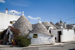 Alberobello-Italy-Monumental complex of trulli. Alberobello-Italy-Puglia-Monumental complex of trulli Stock Photos