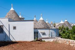 Alberobello, Italy. The picturesque village of trulli. Stone houses built in the typical circular shape with cone roofs stock photography
