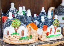 ALBEROBELLO, ITALY - Trulli di Alberobello souvenirs for tourist Stock Images