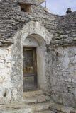 Alberobello: old wooden door broken. Ancient district of Alberobello: old wooden door broken. Puglia. World Heritage Site Stock Photography