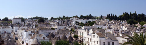 Alberobello panorama. Panorama of Alberobello, Apulia (Italy). Alberobello is well-known for the trulli houses, white-painted dry-stone houses with conical roofs Royalty Free Stock Image