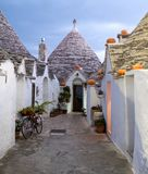 Alberobello, Puglia, Italy. Traditional dry stone conical roofed trullo house with pumpkins for halloween. royalty free stock images