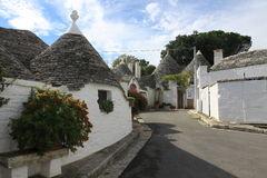 Alberobello road between trulli houses. In Puglia, Italy Royalty Free Stock Image