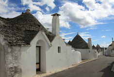 Alberobello road by trulli houses Stock Photography