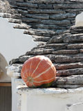 Alberobello's trullo & pumpkin. Trullo, the traditional house of the farmers of Alberobello, southern Italy, with a pumpkin om the roof royalty free stock photo
