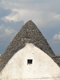 Alberobello`s trullo with window. Trullo, the traditional house of the farmers of Alberobello, southern Italy stock image