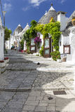 Alberobello_18. Strett view of the beautiful and particular ancient town of Alberobello, in Puglia, Italy Stock Photo