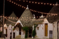 Alberobello trullo at night decorated with hundreds of little li Stock Photos