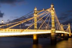 Albert bridge London. Albert bridge in west London photographed after sunset. The bridge was designed 1873 by Rowland Mason Ordish Royalty Free Stock Photography