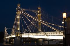 The albert Bridge at night in London. A Close up view of The albert Bridge at night in London Royalty Free Stock Photography