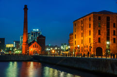 Albert Dock complex in Liverpool, UK. LIVERPOOL, UK - SEPTEMBER 5, 2014: The Pumphouse of Albert Dock at night - complex of buildings and warehouses opened in Royalty Free Stock Photography