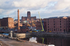 Albert dock Liverpool. Albert dock in Liverpool with the biggest european cathedral in the background, England, UK Royalty Free Stock Photo