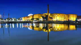 ALBERT DOCK LIVERPOOL. Night image of liverpool Albert dock lights cityscape canal barges liver building hotels steeple waterfront water still reflection Royalty Free Stock Image