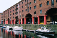 Albert docks warehouses, Liverpool. The renovated warehouses and quayside of the historic Albert docks area, on the banks of the river Mersey in Liverpool. A Royalty Free Stock Photo
