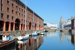 Albert Dock, Liverpool. Yachts moored in Albert Dock with the Three Graces to the rear, Liverpool, Merseyside, England, UK, Western Europe Stock Photos