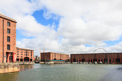 The Albert Dock. A view of the Albert Dock in Liverpool, Northern England. The UNESCO World Heritage site is a complex of dock buildings and warehouses and dates stock image