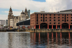 Albert Docks and buildings on the waterfront. The Liver Building , The Port of Liverpool Building from the Albert docks - Liverpool . UK Royalty Free Stock Image