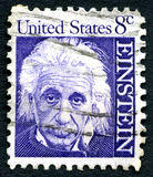 Albert Einstein US Postage Stamp. UNITED STATES OF AMERICA - CIRCA 1965: A used postage stamp from the USA, depicting a portrait of famous physicist Albert Royalty Free Stock Image