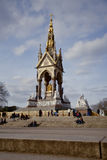 Albert Memorial. London, United Kingdom - February 16, 2013: Albert Memorial, London, United Kingdom, during the day, people sitting on steps and standing by Stock Photos