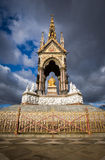 The Albert Memorial, London. A view of the front of the Albert Memorial in London's Kensington Gardens with the sun revealing the gold leaf texture against the stock photo