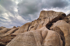 Alberta Badlands. Drumheller Badlands in Alberta, with child climber in the distance Stock Image